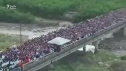 Venesuela sakinləri ərzaq dalınca Kolumbiyaya axışır