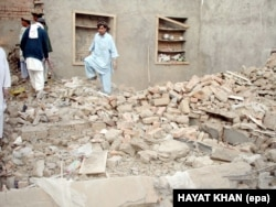 Hayatullah Khan's photo from December 2005 shows local tribesmen inspecting the debris of a house in Mir Shan after an alleged drone attack that killed senior Al-Qaeda commander Abu Hamza Rabia.