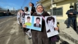 Qalida Akytkhan (center) takes part in a protest near the Chinese Consulate in Almaty in early March.