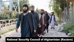Newly freed Taliban prisoners leave a Kabul prison. The son of the late Taliban spiritual leader Mullah Mohammad Omar has been described as a relative moderate who favors a negotiated end to the war.