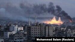 Фаластин- Исроил армияси Ғазо шаҳрига фосфорли бомба отмоқда. 2009 йил, 8 январь.