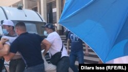 Police detained more than a dozen activists in Shymkent on July 1.