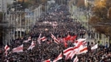 BELARUS -- Opposition supporters parade through the streets during a rally to protest against the Belarus presidential election results in Minsk, October 18, 2020