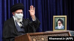 Iranian Supreme Leader Ayatollah Ali Khamenei waves as he addresses people from East Azerbaijan Province by video conference in Tehran on February 17.