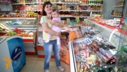 As Russia's Economy Suffers, Young Family Tightens Its Belt