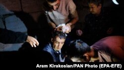NAGORNO KARABAKH -- An injured man receives medical treatment after shelling by Azerbaijani artillery, Stepanakert, October 4, 2020