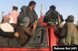 Taliban fighters ride in a vehicle in the Surkhroad district of Nangarhar Province.