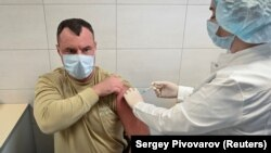 A Russian Army soldier receives an injection of the Sputnik-V vaccine against COVID-19 at a clinic in the city of Rostov-On-Don. Russia has placed its hopes in the domestically produced vaccine instead of lockdown measures.