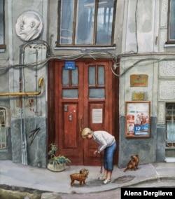 A woman prepares to leash her dogs under a relief of Soviet leader Vladimir Lenin on Pechatnikov Lane.