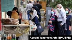 İran-Tehranda maskalı insanlar, 27 iyul, 2021
