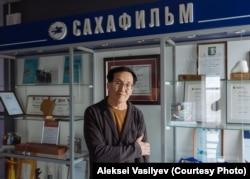"""Aleksei Romanov at the headquarters of Sakhafilm, the movie production company he founded in 1993. """"Shamanism, our traditional faith, and other customs were banned. But now we're bringing them back,"""" he says."""