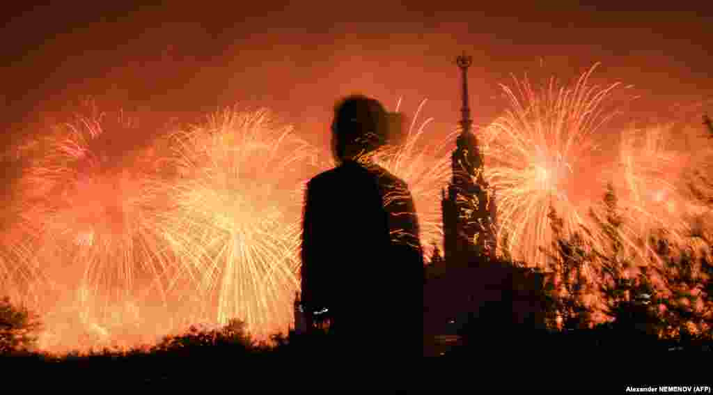 A girl watches fireworks exploding behind Moscow State University during celebrations on June 24 marking the 75th anniversary of the Soviet victory over Nazi Germany in World War Two. (AFP/Alexander Nemenov)