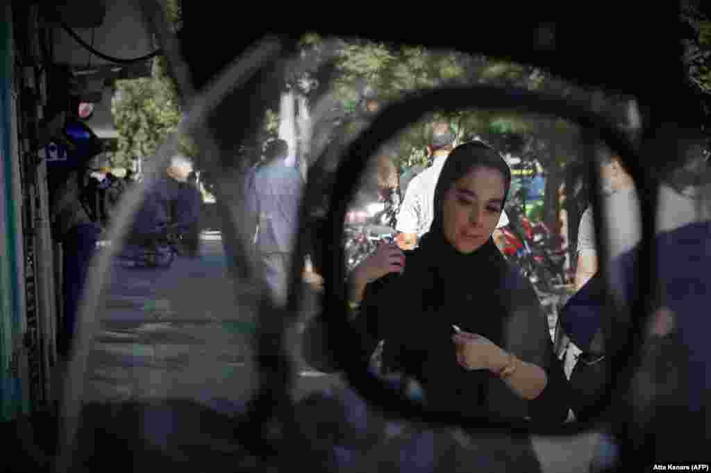A young Iranian woman walks in Tehran.