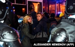 """Riot police detain pro-Navalny protesters in Moscow on February 2. """"I didn't think the Kremlin would go all in on repression as quickly and as deeply as it has,"""" says analyst Sam Greene."""