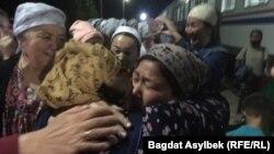 Family members greet new arrivals at the train station in Zhanaozen in Kazakhstan's Manghystau region on May 13.