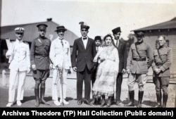 """Weinberg (far left) in his 1921 naval character with """"Princess Fatima,"""" her sons, and several unidentified men."""