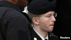 Bradley Manning is escorted into court to receive his sentence at Fort Meade in Maryland on August 21.