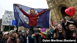 Crowds of demonstrators gather outside the Houses of Parliament during a protest aimed at showing London's solidarity with the European Union.