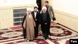 حسن روحانی (نفر اول از راست)، رییس جمهوری منتخب در سفر به قم.