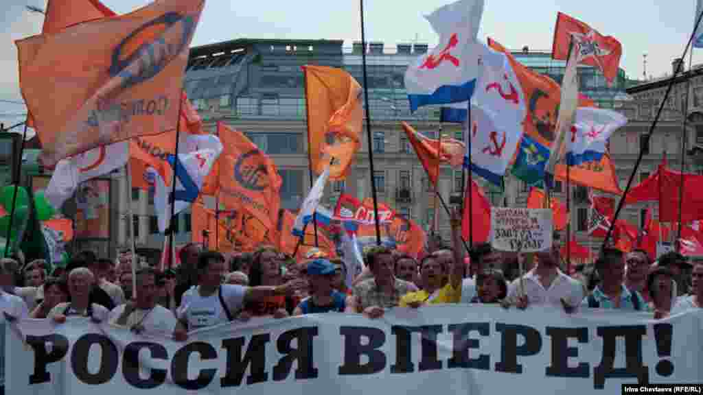 "A banner carried by the opposition Solidary Movement declared ""Russia Forward!"""