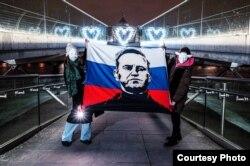 Лондондогу Навальныйды колдогон нааразылык чарасы. 2021-жылдын 14-февралы.
