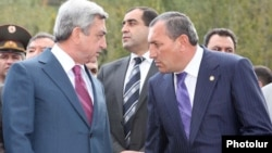 Armenia - President Serzh Sarkisian (L) and Surik Khachatrian, governor of Syunik province, attend an official ceremony.