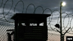 Night falls at Guantanamo Bay detention center's Camp Delta in February 2006.