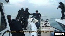 FILE: Bahraini forces raid a speedboat manned by Shi'ite militant fugitives it says were heading for Iran from Bahrain's northeastern coast in February 9.