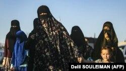 Вступившие в ряды ИГИЛ узбекские женщины и их дети.