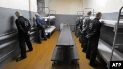 Belarus -- Inmates with life sentences stand at attention facing the walls of their prison cell in expectance of a security guard inside a prison in Glubokoye, 23Jul2009