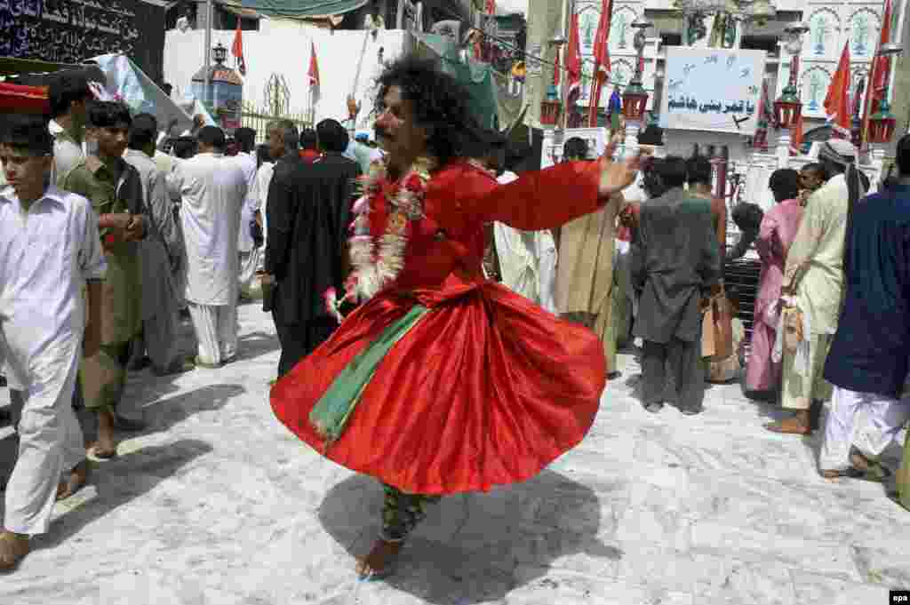 A Sufi devotee dances during annual celebrations at the shrine. Every year, the site is host to the world's largest Sufi festival.