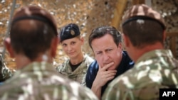 British Prime Minister David Cameron meets British soldiers based at Lashkar Gah in Helmand Province.
