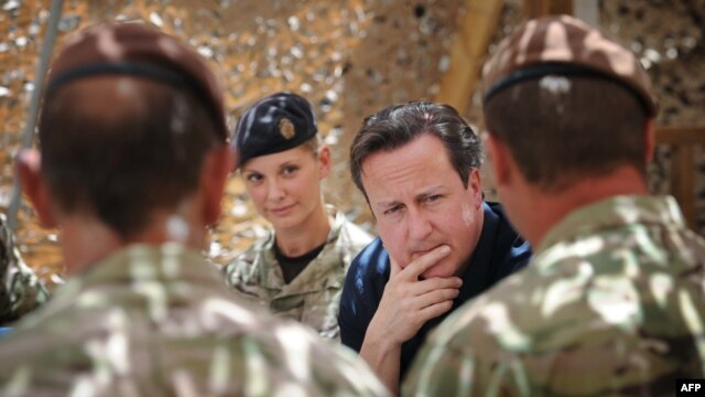 British Prime Minister David Cameron meets British soldiers based in Helmand Province earlier this year.