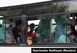 "Commuters wearing masks in ""virus-free"" Ashgabat"