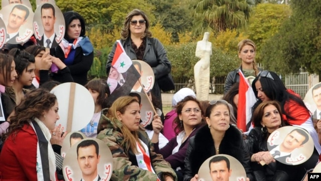 An official handout photo showing Syrian supporters of President Bashar al-Assad protesting in Damascus on November 14.