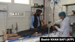 A person injured in the airstrike in Kunduz is treated at a local hospital.