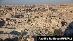 Разрушенные здания в Алеппо.