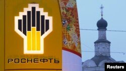 Russia -- The company logo of Rosneft is seen outside a service station in Moscow, November 12, 2013
