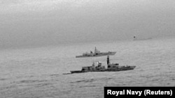 An infrared red image taken from a helicopter shows the Royal Navy frigate HMS St Albans escorting the Russian warship Admiral Gorshkov as it passes close to U.K territorial waters in the North Sea on December 25.