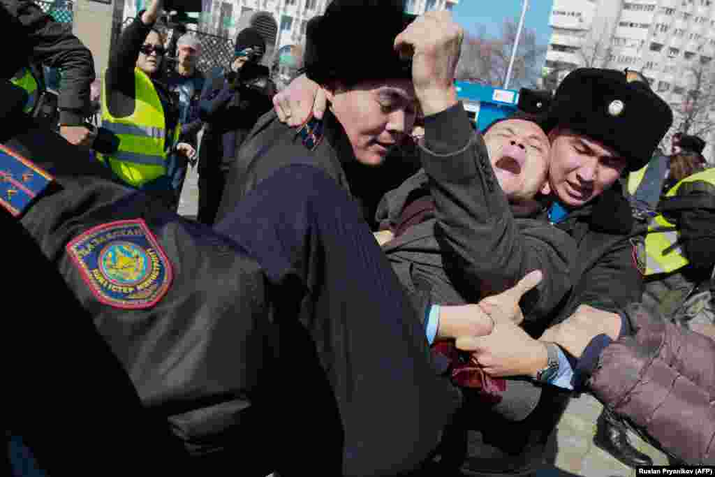 Police in Kazakhstan detained more than 60 people in Almaty on March 1 after an activist's death in jail triggered diplomatic condemnation and calls for anti-government rallies. The protests were called after Dulat Agadil, a prominent activist, died in detention hours after he was detained by plainclothes police. (AFP/Ruslan Pryanikov)