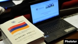 Armenia - A copy of the draft state budget for 2015 lying on a parliament deputy's desk, Yerevan, 1Dec2014.