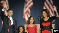 Barack Obama and his family celebrate victory in Chicago.