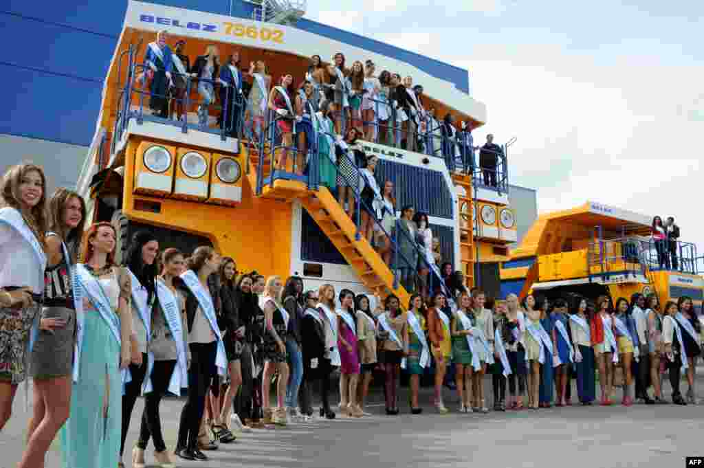 Contestants in the Miss Supranational 2013 beauty contest pose for a photo atop a huge mining truck during a visit to the BelAZ plant in the Belarusian city of Zhodino. Minsk is hosting Miss Supranational 2013, an annual international beauty contest run by the World Beauty Association based in Panama. (AFP/Viktor Drachev)