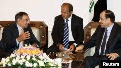 لئون پانهتا (چپ) در دیدار با نوریالمالکی (راست)، نخست وزیر عراق