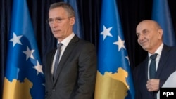 NATO Secretary-General Jens Stoltenberg (left) and Kosovar Prime Minister Isa Mustafa in Pristina on February 3