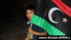 A boy with the anti-Qaddafi Libyan flag in Zawahiya on August 24