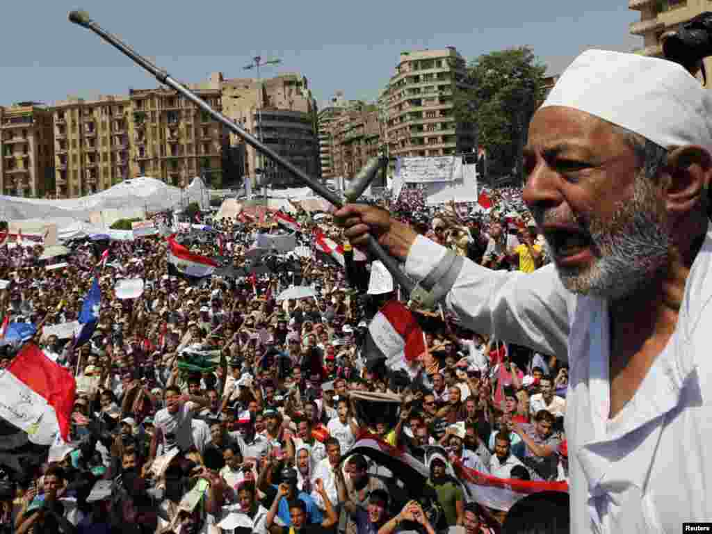 An Egyptian protester chants against the former regime in Tahrir Square in Cairo. Thousands of Egyptians gathered in the iconic square to demand faster reforms and the swifter prosecution of former officials from Hosni Mubarak's toppled government who face corruption and murder charges.Photo by Mohamed Abd El-Ghany for Reuters