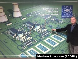 Eduard Svirid points to a site map of the nuclear power plant at the project's information center in Astravets.
