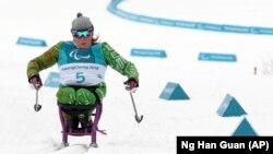 Људмила Ваучок од Белорусија тренира за време на зимските олимписки игри во Пјеонгчанг