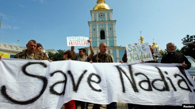 Demonstrators hold signs and banners demanding the release of Nadiya Savchenko, during a rally in Kyiv on July 11.